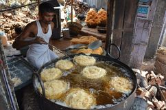 People making Pheni a sweet dish for Roza IftarBreaking the fast Stock Photos