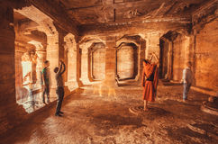 People making pictures by phones inside the 6th century Hindu temple with columns Royalty Free Stock Photos
