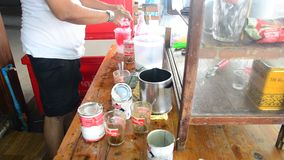 People making red soda water thai style stock video footage