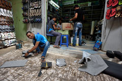 People Making Shoes In A Market In Rissani, Morocco Stock Photography