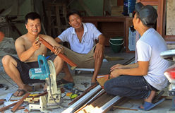 People are making some construction works outdoor. Vinh, Vietnam - May 30, 2015: people are making some construction works outdoor in Vinh, Vietnam royalty free stock image