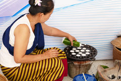 People making sweet and savory grilled coconut rice hotcake Royalty Free Stock Photo