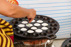 People making sweet and savory grilled coconut rice hotcake Royalty Free Stock Images