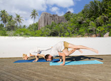 People making yoga exercises outdoors Royalty Free Stock Images