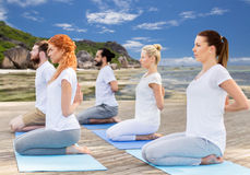 People making yoga in hero pose outdoors Royalty Free Stock Photo
