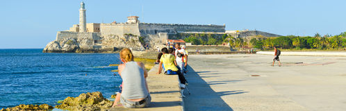 People at the Malecon seawall in Havana Royalty Free Stock Photo