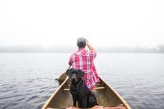 People, Man, Boy, Dog, Black, Boat Stock Photography