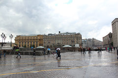People at the Manege Square in the rain. Royalty Free Stock Image