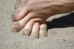People: Man's toes in the sand Royalty Free Stock Image