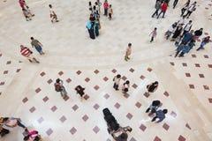 People on marble floor, top view, defocused. People walk in shopping mall on marble floor, top view, defocused photo Stock Photography