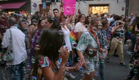 People march during LGBT pride celebrations in mallorca. People march during LGBT pride day celebrations in the street of palma de mallorca. LGBT, or GLBT, is an stock images