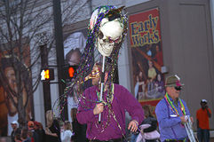 People March in Mardi Gras Parade Stock Photo