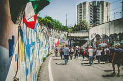 People marching through an urban area Royalty Free Stock Image