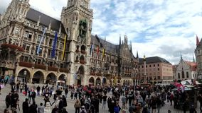 People in Marienplatz square on the the famous Town Hall. Munich, Germany. Time Lapse stock footage