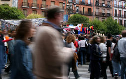 People at the market. Motion blurred people walking at a fleamarket Stock Image