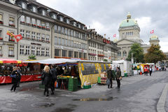 People at the market in front of the national parliament of Bern Royalty Free Stock Image