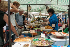 People at market stall. Royalty Free Stock Images