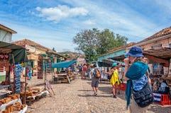 People at a market in Trinidad, Cuba. Trinidad, Cuba -March 8, 2016: Souvenir market  on a cobblestone street in Trinidad, Cuba Stock Photography