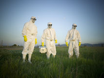 People with mascs. Three people with masks standing in the field Royalty Free Stock Images