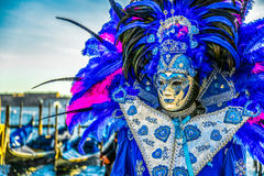 People in masks and costumes on Venetian carnival. People from all over the world come to the Venice Carnival Stock Photography