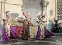 People in masks and costumes on Venetian carnival. People from all over the world come to the Venice Carnival Royalty Free Stock Images