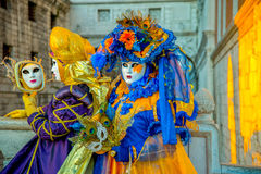People in masks and costumes on Venetian carnival. People from all over the world come to the Venice Carnival Royalty Free Stock Photography