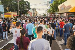 People at the mass of Corpus Christi. Campo Grande, Brazil - May 31, 2018: Holiday event of Corpus Christi at the 14 de Julho street. People at the mass of Stock Image