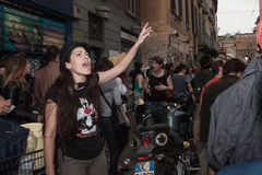 People at the May Day parade in Milan. MILAN, ITALY - MAY 1, 2013: A young woman shouts while people march in the street for the traditional celebration of the Stock Photos