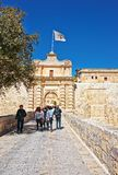 People at Mdina Gate and entrance into old city Malta. Mdina, Malta - April 4, 2014: People at Mdina Gate and entrance into the old fortified city, Malta Royalty Free Stock Image