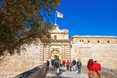 People at Mdina Gate and entrance in old city Malta. Mdina, Malta - April 4, 2014: People at Mdina Gate and entrance in the old fortified city, Malta Stock Image