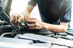 People or mechanic car repair during investigate cause of problem electric system check or working on automobile gasoline or. Diesel engine at garage royalty free stock photo