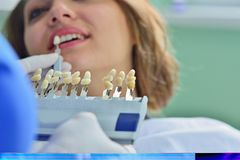 People, medicine, stomatology and health care concept - happy female dentist checking patient girl teeth Stock Image