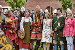 People in medieval clothes Stock Photography