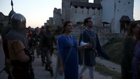 People in medieval clothes pass by stock video footage