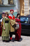 People in medieval costumes. This image represents four people dressed in medieval costumes! They were making an old city tour in Sighisoara, Romania, singing Royalty Free Stock Image