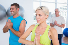 People meditating in fitness club Royalty Free Stock Images