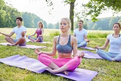 People meditating in wellness workshop. People meditating together in wellness workshop in the nature Royalty Free Stock Image