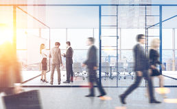 People in meeting room with glass walls, double. 3d rendering. Rear view of businesspeople standing and passing by a meeting room with glass walls in a busy Stock Photos