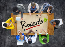 People in a Meeting and Single Word Rewards Royalty Free Stock Images