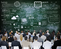 People in a Meeting with Social Media Concepts Stock Image