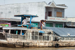 People of Mekong Delta, Cai Be, Vietnam. Mekong Delta, Cai Be District, Tien Giang Province, Cai Be Town, Cai Be Floating Market, South Vietnam, local people at Royalty Free Stock Photography