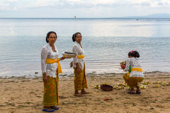 People during Melasti Ritual. Ceremony is held on the edge of the beach Royalty Free Stock Photography