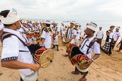 People during Melasti Ritual. Ceremony is held on the edge of the beach Stock Photos