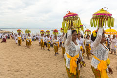 People during Melasti Ritual. Ceremony is held on the edge of the beach Stock Photography