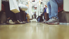 People in the metro. Floor view of people sitting in the metro stock photography