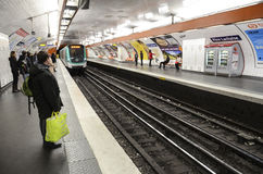 People at metro station, Paris. People waiting at metro station, Paris royalty free stock images