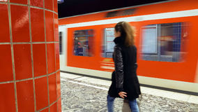 People at the metro subway station. Hamburg, Germany - October, 10, 2016: People at subway metro underground tube station walk to get the arriving train Royalty Free Stock Photos