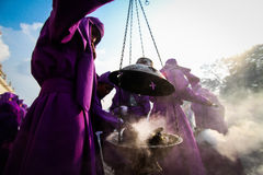 People in the middle of the incense of a procession Stock Images