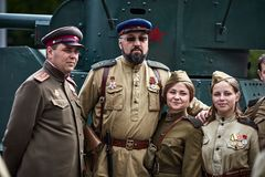 People in military uniform in honor of the Victory Day holiday. Stock Photos