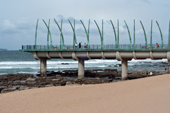 People on the Millennium Pier at the beach in Umhlanga Rocks Stock Photography
